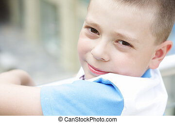 Boy looking over shoulder - Cute boy in blue and white shirt...