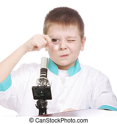 Boy looking to magnifying glass