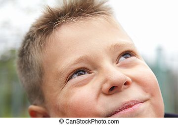 Boy looking to sky closeup