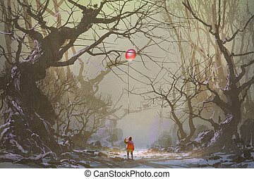 alone in dark forest - boy looking up red balloon stuck in a...