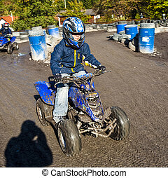 boy loves to race with a kart at the muddy kart track
