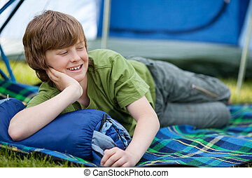 Boy Lying On Sleeping Bag