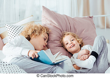 Boy lying with book