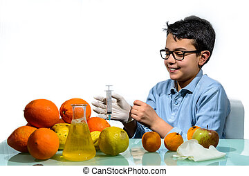 Boy Make the Experiments with Fruit. - The boy performs...