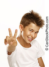 boy make victory sign
