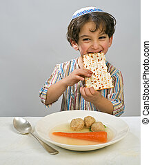 boy matzo ball soup - Jewish young boy having matzo ball...
