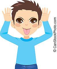 Boy Mocking Expression - Little boy making mocking...