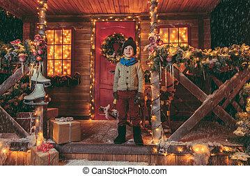 boy near fairy-tale house