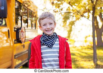 boy near schoolbus