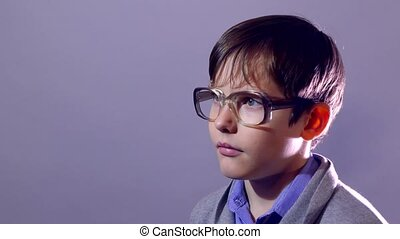 boy nerd teenager portrait schoolboy  glasses on purple background education