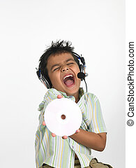 boy of indian origin with cd - an excited Asian boy of...