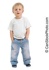 Boy of three years, dressed in a white shirt and blue jeans poses