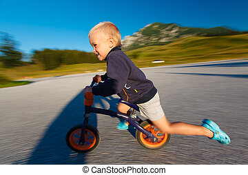 Boy on a bicycle.