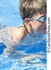 Boy on a swimming pool