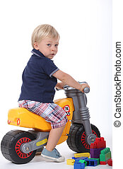 Boy on a toy motorbike