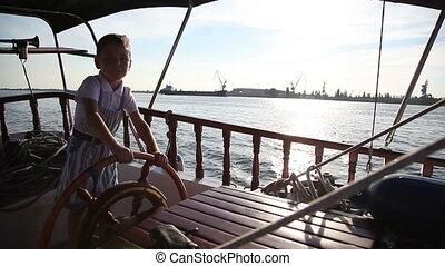 boy on a yacht