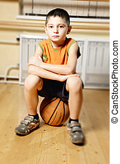 Boy on basketball