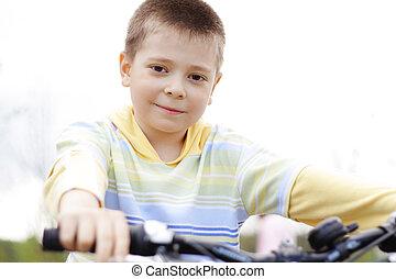Boy on bike focus on eyes