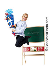 Boy on first school is happy and jumps in the air.