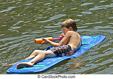 Boy on Float in Water