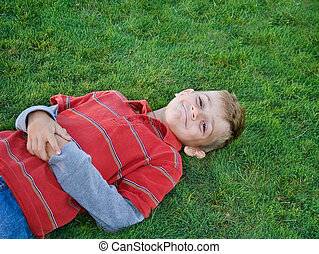 Boy on green grass.