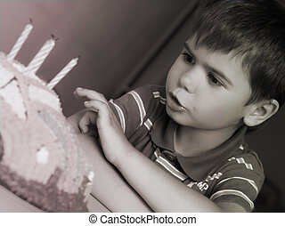 boy on his birthday, making a wish