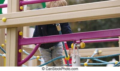 Boy on playground equipment.