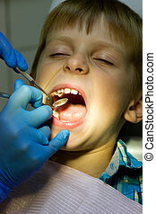 boy on reception at the dentist - 9 years old boy on...