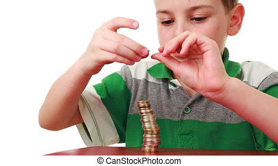 boy on red base puts coins in column, then they fall down -...