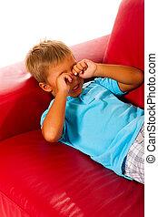 boy on red sofa