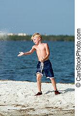 Boy on Sandbar - Young boy playing on sandbar