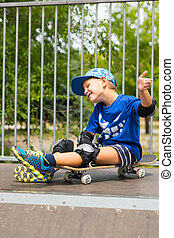 Boy on Skateboard Making Excited Hand Gesture