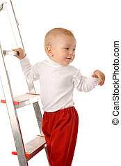 boy on step ladder - small boy in red pants on step ladder