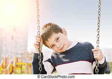 Boy on swings