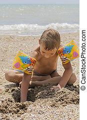Boy on the beach playing