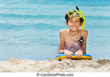Boy on the board ready for swimming in sea