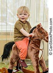Boy on the carousel