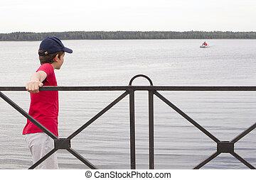 Boy on the lake shore