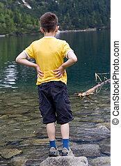 boy on the lake