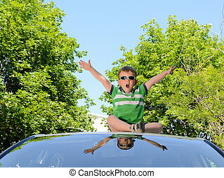 Boy on the roof of car