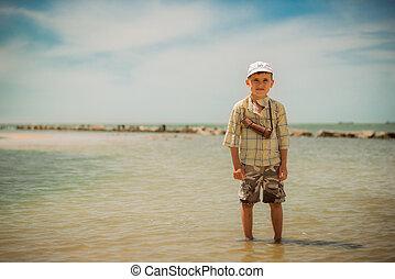 Boy on the sea
