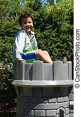 Boy on top of castle