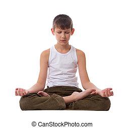 Boy on white background meditating