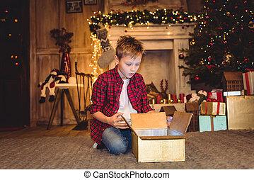 Boy opening christmas present
