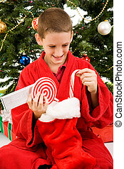Boy Opening Christmas Stocking