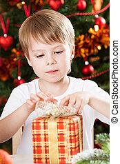 Boy opening Xmas present