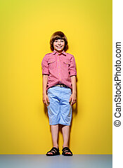 boy over yellow background