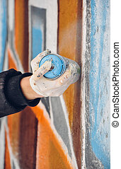 Boy painting graffiti close-up