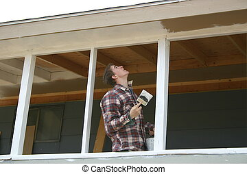 Boy Painting - Young man painting a newly constructed porch.
