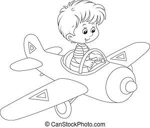 Boy pilot - Little boy flying in a toy plane